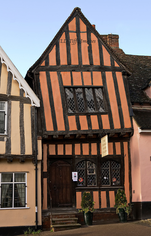 Lavenham townscapes and architecture: distinctive crooked house leans against its neighbor.