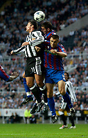 Photo. Jed Wee<br /> Newcastle United v Partizan Belgrade, European Champions League Qualifier, St. James' Park, Newcastle. 27/08/2003.<br /> Newcastle's Gary Speed (L) jumps highest to win the ball from a pair of Partizan defenders.