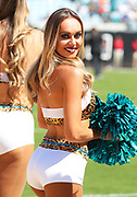 Oct 13, 2019; Jacksonville, FL USA;  A Jacksonville Jaguars cheerleader performs during an NFL game against the New Orleans Saints at TIAA Bank Field in Jacksonville, FL. The Saints beat the Jaguars 13-6. (Steve Jacobson/Image of Sport)