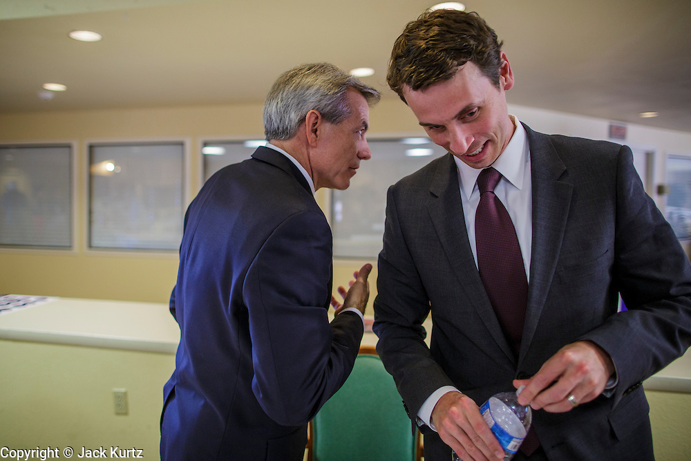 09 AUGUST 2012 - SCOTTSDALE, AZ:  Congressmen DAVID SCHWEIKERT (R-AZ), left, and BEN QUAYLE (R-AZ) share a private moment after a candidate forum at an adult assisted living facility in Scottsdale, AZ, Thursday. Republican Congressmen Ben Quayle and David Schweikert are facing each other in Arizona's Aug. 28 Republican primary. They are vying for the right to represent Arizona's 6th Congressional District. Both men are incumbent freshmen Congressmen. They were thrown into the same district during the redistricting process after the 2010 census. Both men are conservatives courting the Tea Party vote.   PHOTO BY JACK KURTZ
