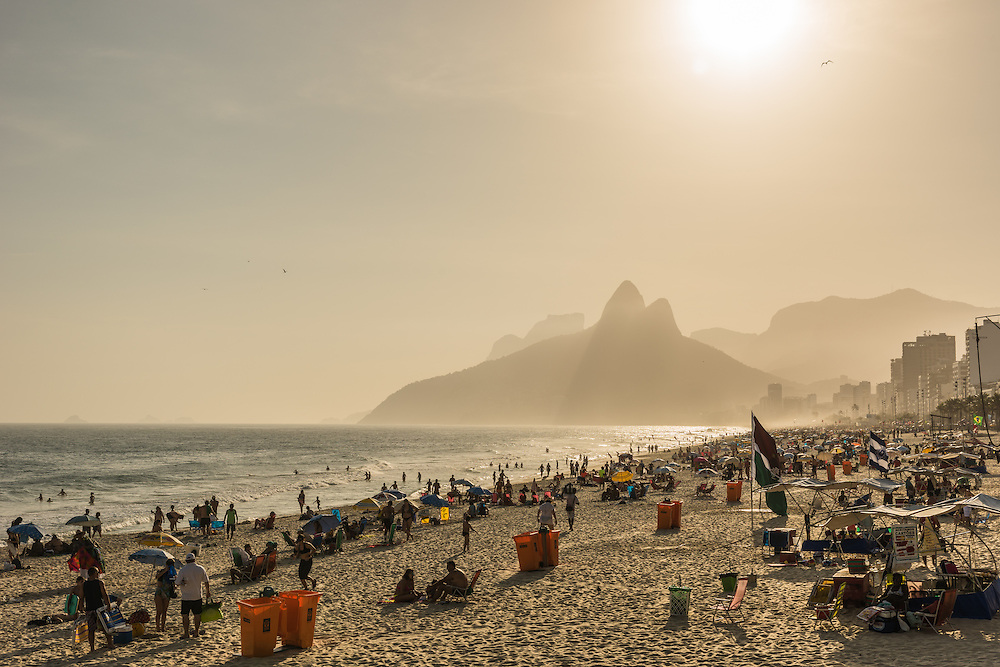 Ipanema beach full with people on a Friday at sunset, Rio de Janeiro, Brazil.