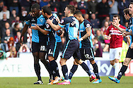 Aaron Pierre of Wycombe Wanderers (left) celebrates scoring his team's first goal to make it 1-1 during the Sky Bet League 2 match at Adams Park, High Wycombe<br /> Picture by David Horn/Focus Images Ltd +44 7545 970036<br /> 18/04/2014
