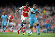 Arsenal's Danny Welbeck being chased by Manchester City's Martin Demichelis. Barclays Premier league match, Arsenal v Manchester city at the Emirates Stadium in London on Saturday 13th Sept 2014.<br /> pic by John Patrick Fletcher, Andrew Orchard sports photography.