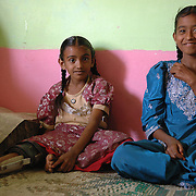 Naziasultana (10, left) and her sister Hazeera (12) at home in one of Bangalore's urban slums. Naziasultana suffers from cerebral palsy and is treated by APD in the last 2 years. After a surgery (TA) a year ago, she can now walk freely without her calipers.
