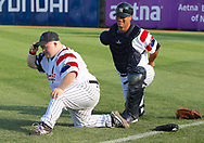 July 5, 2017 - Trenton, New Jersey, U.S - Trenton Thunder bat boy (and participant in the Special Olympics) TOMMY SMITH stretches with Thunder catcher JORGE SAEZ before the game tonight vs. the Fightin Phils at ARM & HAMMER Park. (Credit Image: © Staton Rabin via ZUMA Wire)