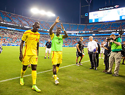 CHARLOTTE, USA - Saturday, August 2, 2014: Liverpool Mamadou Sakho and Kolo Toure after the 2-0 victory over AC Milan during the International Champions Cup Group B match at the Bank of America Stadium on day thirteen of the club's USA Tour. (Pic by David Rawcliffe/Propaganda)
