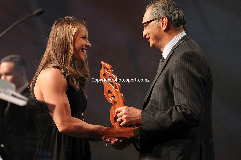 301113 2013  Kevin Pryor presents the Maori Sportsperson of the Year Award to Lisa Carrington for canoeing at the Trillian Trust Maori Sports Awards at Vodafone Events Centre, Manukau. Photo: Fiona Goodall/photosport.co.nz