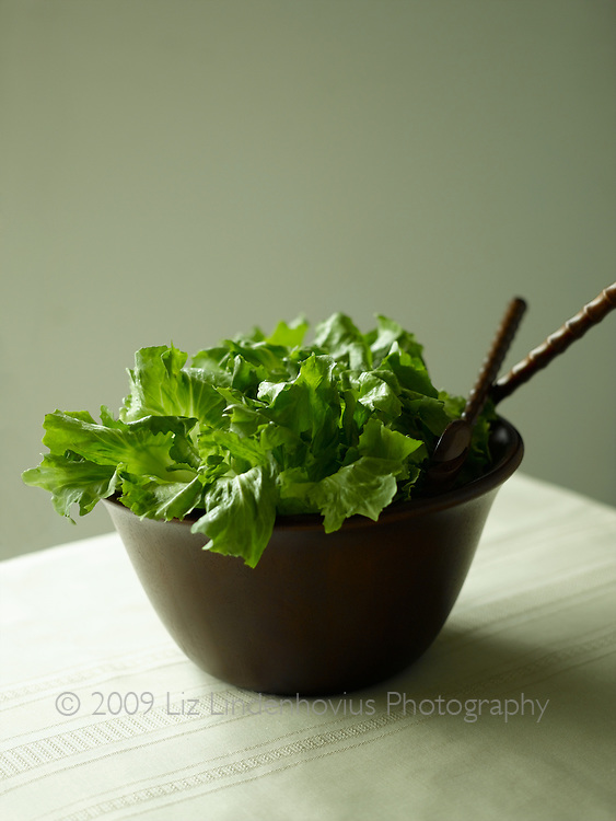 Green Lettuce in wooden bowl