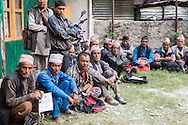 Homeowners from Dolakha, many who traveled over three hours by foot, lineup to receive the first installment, Rs 50,000 of the promised Rs200,000 to rebuild their homes in Singati Bazaar in Dolakha, Nepal  April 13, 2016. Less than one-tenth of a percent, approximately 700 of the 770,000 owners of the affected households, have received cash grants from the government to rebuild their homes.  <br /> Gurkha was one of the hardest hit areas, including the Singati Bazaar, where over 100 bodies were buried under the ruble following the 7.8 magnitude April 25, 2015 earthquake and May 12th aftershock. Singati was the major market for residents of 21 Village Development Committees and many survivors of the April 25th earthquake were in the bazaar buying supplies when the aftershock hit causing a huge landslide.<br /> &copy; 2016 Michelle McLoughlin