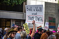 "San Francisco, USA. 19th January, 2019. The Women's March San Francisco proceeds down Market Street. A sign held high reads: ""Build a wall around Trump Tower."" Credit: Shelly Rivoli/Alamy Live News"