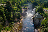 Summer veiw of Rainbow Falls and hydro electric building, Ausable River, Ausable Chasm, New York
