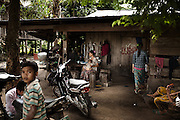 Daily life in Srae Sronok, one of the villages that will be flooded by the reservoir of the $800 million Lower Sesan 2 dam. All the houses in the village have been spray-painted in red with the LSS2 sign, meaning the owners will soon be forced to relocate. Stung Treng, northern Cambodia.