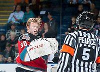 KELOWNA, CANADA - OCTOBER 11:   Jordon Cooke #30 of the Kelowna Rockets speaks to referee Mark Pearce about a call on the Seattle Thunderbirds on October 11, 2013 at Prospera Place in Kelowna, British Columbia, Canada (Photo by Marissa Baecker/Shoot the Breeze) *** Local Caption ***