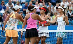 Australia's Ashleigh Barty (left) and Casey Dellacqua (centre left) shake hands with Chinese Taipei's Yung-jan Chan (centre right) and Switzerland's Martina Hingis after the Women's Doubles Final during day nine of the AEGON International at Devonshire Park, Eastbourne.