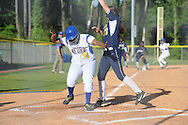 Oxford High's Aulysha Booker scores as Pearl's Kamerine Smith(17) covers the plate in MHSAA Class 5A playoff action in Oxford, Miss. on Friday, April 25, 2014.