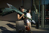 Two women shop in the Roppongi Hills shopping mall, Tokyo.