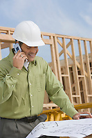 Construction worker studying blueprint