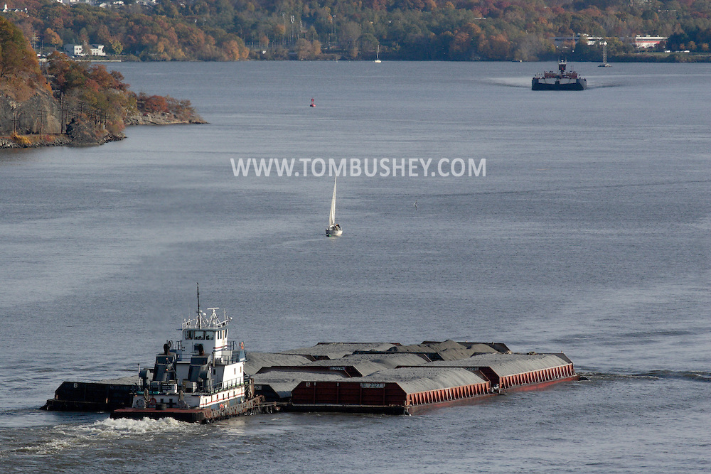 Fort Montgomery, NY - A tugboat pushes a barges down the Hudson River by the Bear Mountain Bridge  on Nov. 2, 2008.
