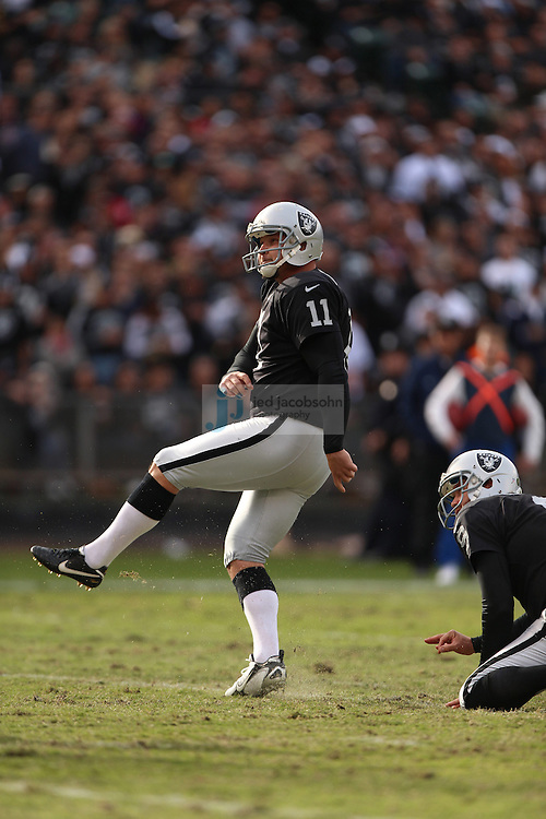 Oakland Raiders place kicker Sebastian Janikowski (11) in action against the New Orleans Saints during an NFL game on Sunday, Nov. 18, 2012 at the Oakland Coliseum in Oakland, Ca. (AP Photo/Jed Jacobsohn)