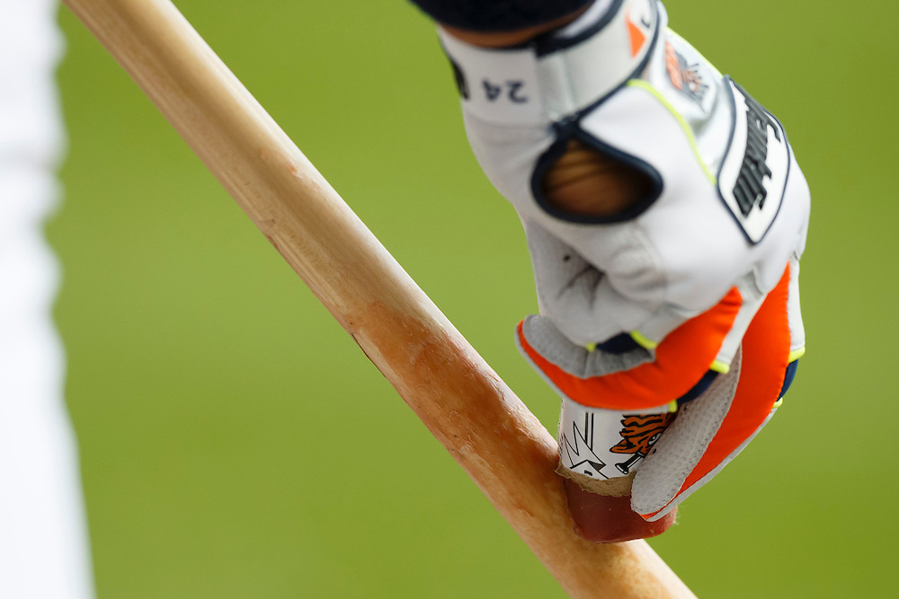May 23, 2014; Detroit, MI, USA; Detroit Tigers first baseman Miguel Cabrera (24) uses a grip stick on his bat against the Texas Rangers at Comerica Park. Mandatory Credit: Rick Osentoski-USA TODAY Sports