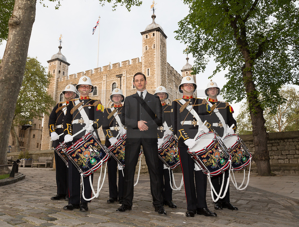 © Licensed to London News Pictures. 30/04/2014. London, UK. Royal Marines pose in front of the Tower of London on 30th April 2014 with British actor, Tom Hardy. The Royal Marines Corps of Drums are attempting to break the World record for the longest continuous drum roll as part of a year of celebrations to mark the 350th anniversary of the Royal Marines and raising money for the Royal Marines Charitable Trust Fund. The current record stands at 28 hours, 19 minutes and 3 seconds and they hope to extend this to 64 hours. Photo credit : Vickie Flores/LNP