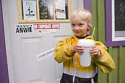 Child enjoys a drink at a cafe near Whitehorse