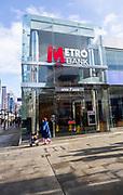Signs on Metro Bank building, Regent Street, Swindon, Wiltshire, England, UK