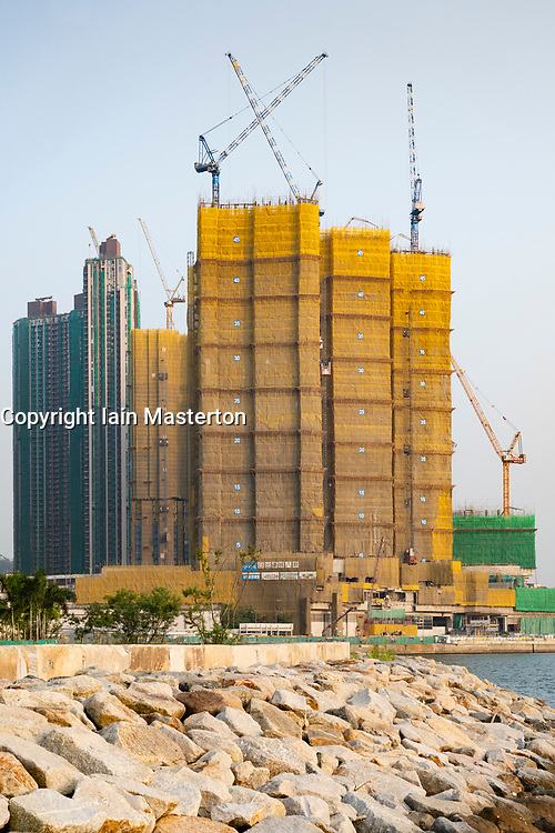 Construction of new  dense urban high-rise apartment buildings in LOHAS Park new housing estate in New Territories of Hong Kong, China.