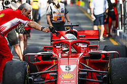March 25, 2018 - Melbourne, Victoria, Australia - Scuderia Ferrari Managing Director & Team Principal MAURIZIO ARRIVABENE, left, congratulates race winner SEBASTIAN VETTEL Scuderia Ferrari SF71H in the paddock after the 2018 Formula One Australian Grand Prix, at Albert Park. (Credit Image: © Hoch Zwei via ZUMA Wire)