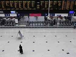 © Licensed to London News Pictures. 07/09/2020. London, UK. A rail passenger waits for a train at Waterloo Station. Train capacity is supposed to reach 90% today as holidays come to an end and schools return. Photo credit: Peter Macdiarmid/LNP