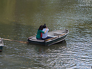 Couple taking a selfie in a rowboat on The Lake in Central Park