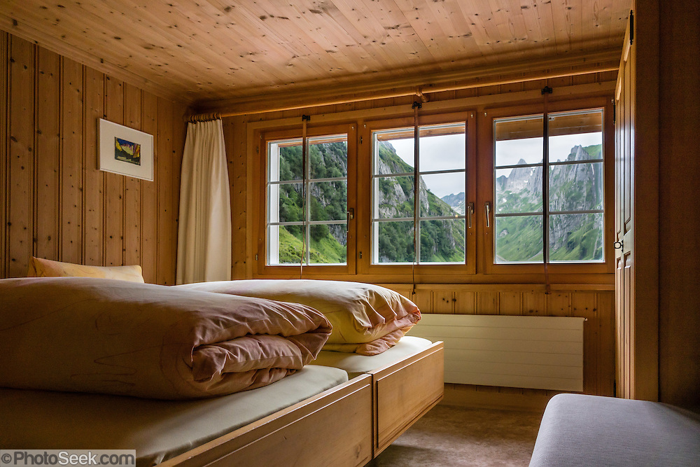 This comfy private double ensuite room has a wonderful view of peaks and Fälensee lake, at Berggasthaus Bollenwees, founded in 1903. A spectacular ridge walk covered in wildflower gardens starts at Hoher Kasten, reached via cable car from Brülisau, just 10 minutes bus ride from Appenzell village. For a wonderful day hike, take the lift; or arranging for overnight stay at Berggasthaus Staubern or beautiful Bollenwees allows time to ascend Hoher Kasten summit (1794 m) on foot. Appenzell Innerrhoden is Switzerland's most traditional and smallest-population canton (second smallest by area).