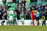 Andrew Considine (#4) of Aberdeen questions Hibernian's first goal scored by Martin Boyle (#17) of Hibernian as Hibernian players celebrate during the Ladbrokes Scottish Premiership match between Hibernian and Aberdeen at Easter Road, Edinburgh, Scotland on 17 February 2018. Picture by Craig Doyle.