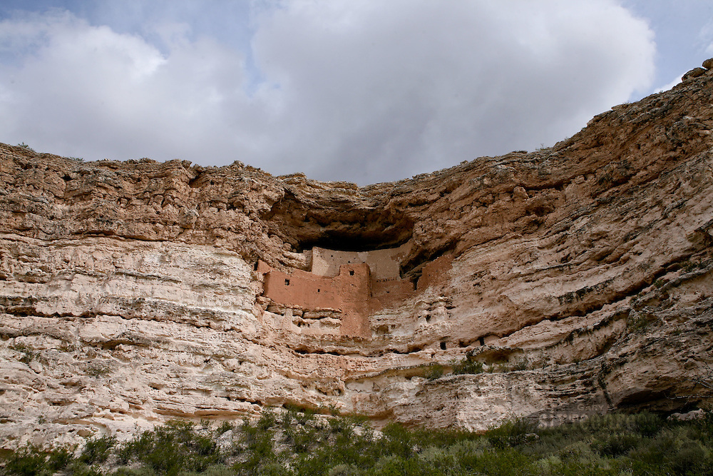 Photo by Gary Cosby Jr.  ..A dwelling of ancient indians sits high up in the cliffs in Arizona.  The cliff dwelling is known as Montezuma's Castle.