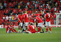 Photo: Rich Eaton.<br /> <br /> Barnsley v Cardiff City. Coca Cola Championship.<br /> <br /> 05/08/2006. Barnsley players sit down on the pitch and reflect after a 2-1 home defeat in the first game of the season