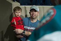 KELOWNA, CANADA - FEBRUARY 24: A young fan stands with his father to high five Kelowna Rockets' players as they exit the ice after warm up against the Kamloops Blazers  on February 24, 2018 at Prospera Place in Kelowna, British Columbia, Canada.  (Photo by Marissa Baecker/Shoot the Breeze)  *** Local Caption ***