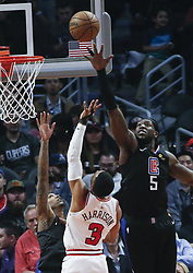 March 15, 2019 - Los Angeles, California, U.S - Los Angeles ClippersÃ• Montrezl Harrell (5) blocks a shot by Chicago Bulls' Shaquille Harrison (3) during an NBA basketball game between Los Angeles Clippers and Chicago Bulls Friday, March 15, 2019, in Los Angeles. The Clippers won 128-121. (Credit Image: © Ringo Chiu/ZUMA Wire)