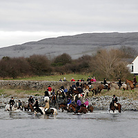 Paticipants in the Ballyvaughan Hunt bring their horses down to the shore to wash their legs on Sunday.<br />