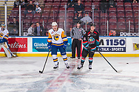 KELOWNA, CANADA - DECEMBER 1: Riley McKay #39  takes part in a pre-game conversation with Michael Farren #16 of the Kelowna Rockets during warm up on December 1, 2018 at Prospera Place in Kelowna, British Columbia, Canada.  (Photo by Marissa Baecker/Shoot the Breeze)