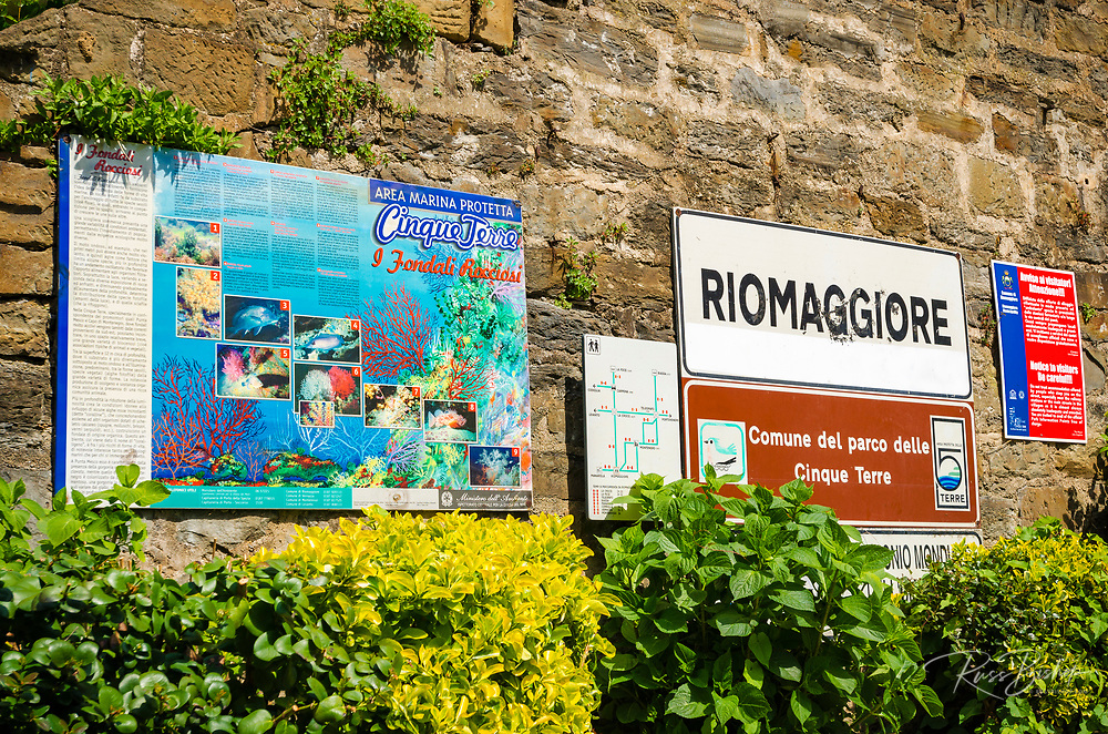 Welcome sign and protected marine life sign at the Riomaggiore train station, Cinque Terre, Liguria, Italy