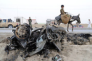 "Pilot, Danielle Aitchison and her partner Chris Hood, narrowly missed being hit by a suicide bomber very similar to the one seen here.  On March 13, 2008 a suicide car bomber rammed into a military convoy on Airport Road, near Kabul International Airport.  The blast killed 6 and injured 15.  Danielle said the blast was 40 meters behind the car she was traveling in and pushed her forward in her seat.  ""We got out of their as quickly as possible, because unfortunately you might go to try and help, but a second one might come and try to kill more people.  That was a very humbling experience that brought you right back to where you were and the dangers of being here."". .Pictured here:.A suicide bomber rammed his car into a NATO convoy on Monday, August 11th, 2008, in Kabul, Afghanistan.  According to reports a British soldier and 3 Afghan citizens were killed with at least a dozen more injured."