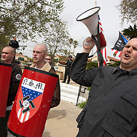 Members of the National Socialist Movement, a Neo Nazi group, led by Southwestern Regional Director Jeff Russell Hall, with megaphone, rallies in Claremont, California against illegal immigration. Please contact Todd Bigelow directly with your licensing requests.
