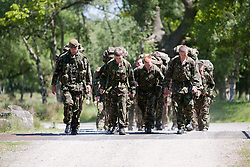 Captain Stewart Bridgehouse of the Scots Guards Regimental Support Team, left, with the soldiers trying army life, on the 2 mile march..Exercise Guards Warrior with the Scots Guards at their Catterick base..Pic ©2010 Michael Schofield. All Rights Reserved.
