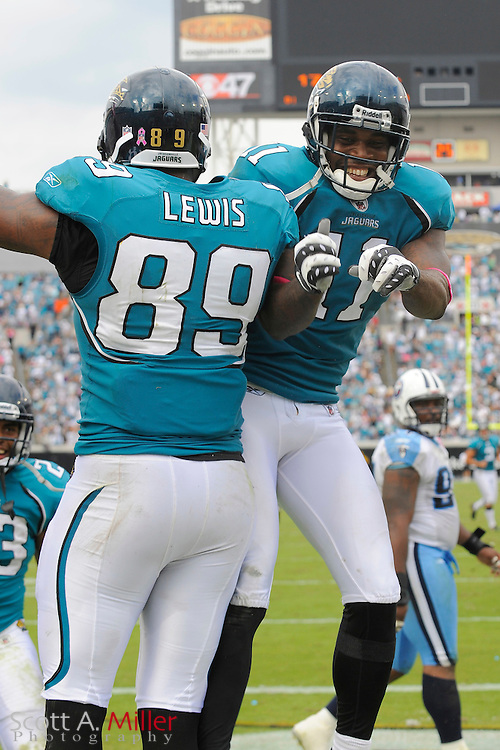 Oct. 4, 2009; Jacksonville, FL, USA; Jacksonville Jaguars tight end Marcedes Lewis (89) and wide receiver Mike Sims-Walker (11) celebrate a touchdown during the Jags 37-17 win over the Tennessee Titans at Jacksonville Municipal Stadium. ©2009 Scott A. Miller