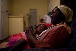 Francisca Guity, a woman who is HIV-Postive, sits with her child in her home on January 20, 2013  in Sambo Creek, Honduras. (David Rochkind/ Pulitzer Center)