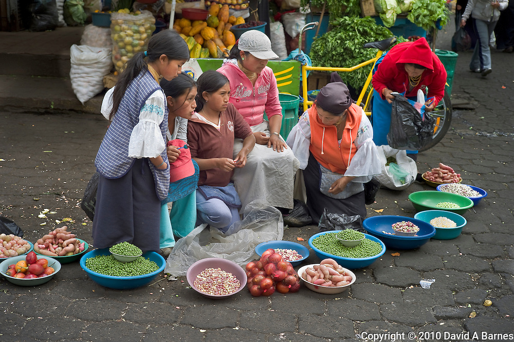 Famitly selling bean and poptatos in the market at Otavalo, Imbabura, Ecuador
