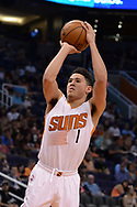 Apr 9, 2017; Phoenix, AZ, USA; Phoenix Suns guard Devin Booker (1) shoots the ball against the Dallas Mavericks in the second half of the NBA game at Talking Stick Resort Arena. The Suns won 124-111. Mandatory Credit: Jennifer Stewart-USA TODAY Sports