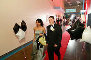 Seniors Collen Hicks (right) and Shavell Marshall are the first to enter the first Belmont High School Prom at the new Belmont High School building on Wayne Avenue in Dayton, Saturday, April 28, 2012.
