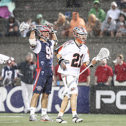 Ethan Vedder #21 of the Denver Outlaws and Paul Rabil #99 of the Boston Cannons react to a play during the game at Harvard Stadium on May 10, 2014 in Boston, Massachusetts. (Photo by Elan Kawesch)