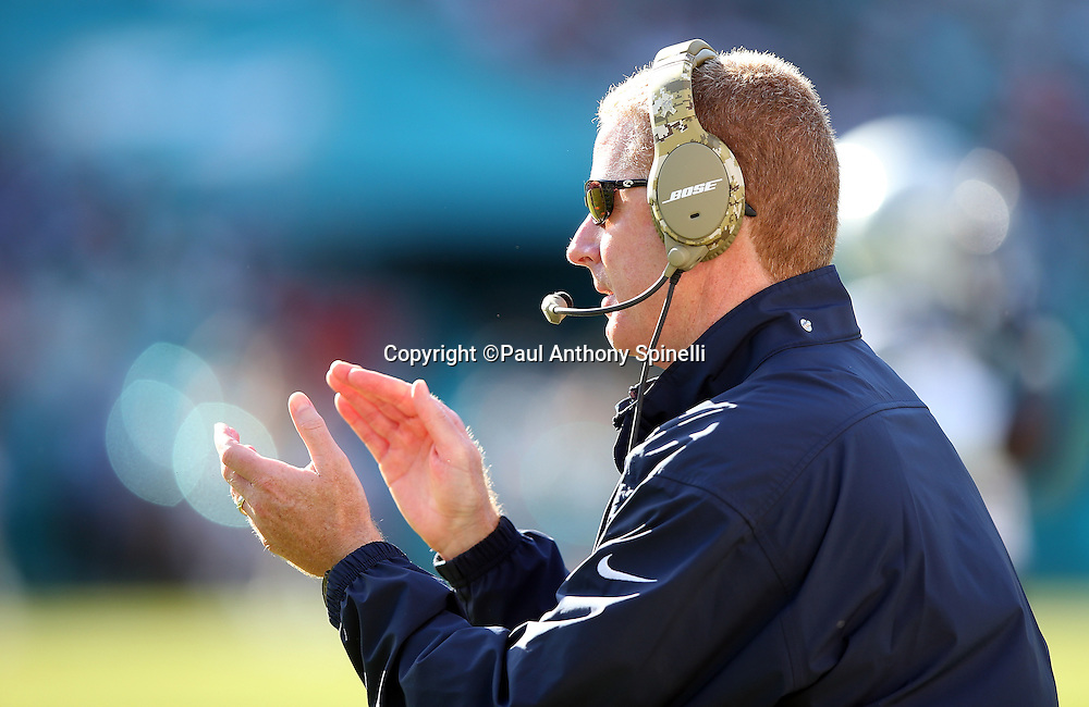 Dallas Cowboys head coach Jason Garrett claps on the sideline during the 2015 week 11 regular season NFL football game against the Miami Dolphins on Sunday, Nov. 22, 2015 in Miami Gardens, Fla. The Cowboys won the game 24-14. (©Paul Anthony Spinelli)